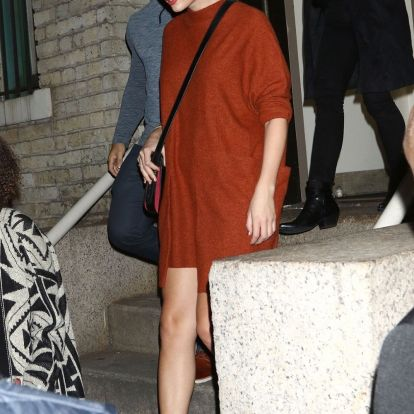 Taylor Swift wore a cozy dress from Free People with Designer It Boots 2019