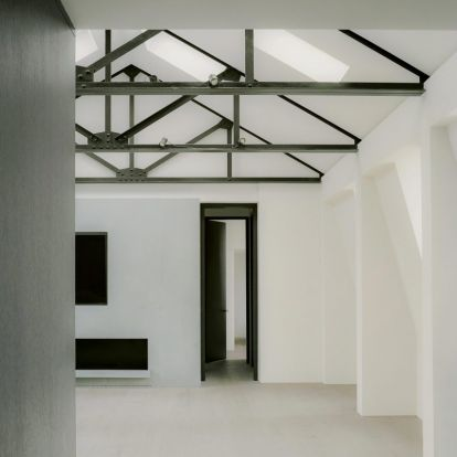 Art takes centre stage in monochrome London loft by Originate