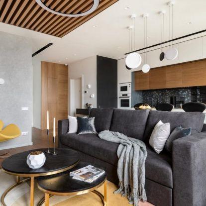 Természetes anyagok, kő, fa és kontrasztos, modern dekoráció 56m2-en – fiatal nő kétszobás lakása