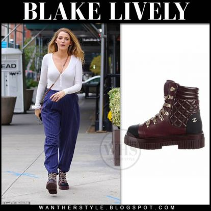 Blake Lively in burgundy hiking boots, blue pants and black studded bag in NYC on October 13